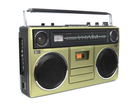 boombox: A stylish gold boombox radio from the 1970s isolated on white.