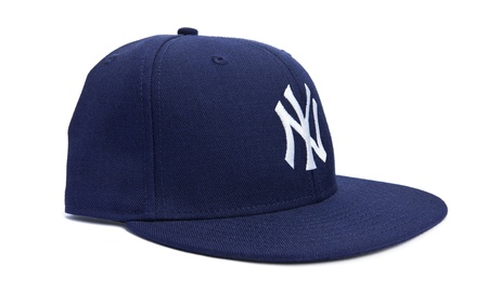 fitted: Taipei, Taiwan - December 17, 2012: This is a studio shot of a blue New York Yankees hat made by New Era isolated on a white background. Editorial