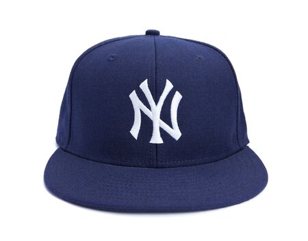 Taipei, Taiwan - December 17, 2012: This is a studio shot of blue New York Yankees hat made by New Era isolated on a white background. Editorial
