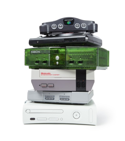 Taipei, Taiwan - November 13, 2012: This is a studio shot of various game consoles stacked on each other isolated on a white background.