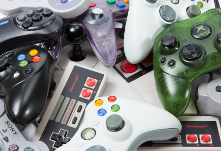 Taipei, Taiwan - November 13, 2012: This is a studio shot of various game controllers isolated on a white background.