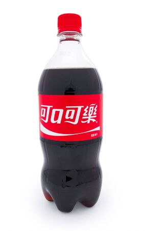 Taipei, Taiwan - January 8, 2012: This is a studio shot of a traditional Chinese bottle of Coca-Cola made by The Coca-Cola company isolated on white. Stock Photo - 17465205