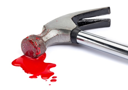 A close-up of a bloody hammer and small blood pool  red paint  isolated on white