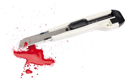 A blood covered boxcutter and spatter of blood isolated on a white background. Stock Photo - 17473658