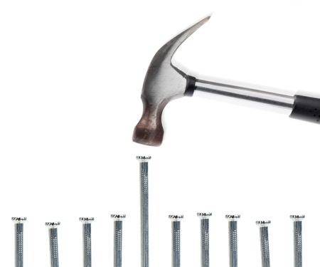 A nail being hammered on a white background based on the proverb,  Stock Photo