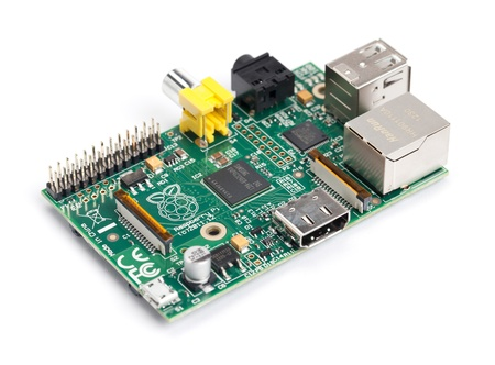 raspberries: Taipei, Taiwan - January 10, 2013: This is a studio shot of a Raspberry Pi circuit board isolated on white. Editorial