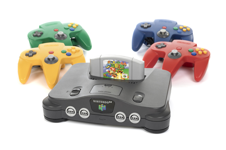 Taipei, Taiwan - February 18, 2018: A studio shot of a Nintendo 64 system with four controllers and game on a white background.