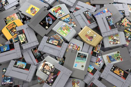 Taipei, Taiwan - February 20, 2018: A studio shot of a heap of Nintendo games shot from above. Stok Fotoğraf - 100388498