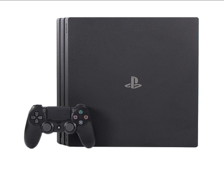Taipei, Taiwan - December 8, 2018: The Sony Playstation 4 Pro system with controller isolated on a white background.