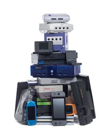 Taipei, Taiwan - September 9, 2019: A large pile of both old and new video game systems isolated on white. Editorial