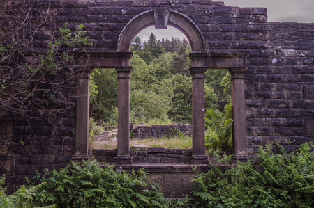 The ruins of Errwood Hall at Goyt valley within the Peak District National park.