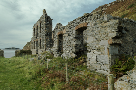 The abandoned ruined factory buildings of the Llanlleiana old porcelain works at Llanbadrig, Cemaes Bay, Anglesey.
