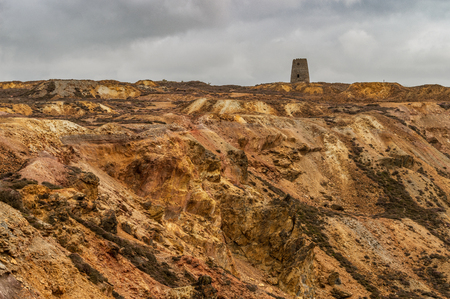 The orange and brown landscape of the disused Parys Mountain copper mine, Anglesey, North Wales.