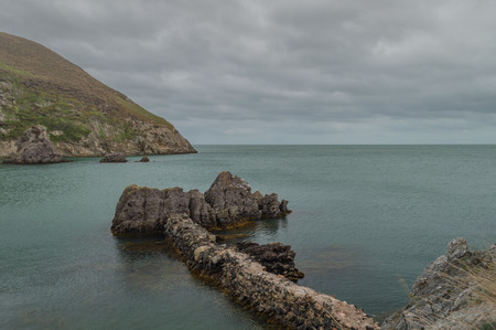 The ruins of the brickwork factory at Porth Wen, Llanbadrig, Anglesey. 스톡 콘텐츠 - 110989375