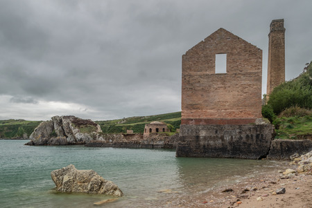 The ruins of the brickwork factory at Porth Wen, Llanbadrig, Anglesey. 스톡 콘텐츠 - 110989381