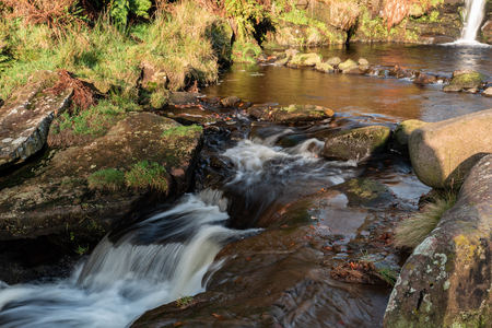 Cascading water at Three Shires Head in the Peak District National Park.