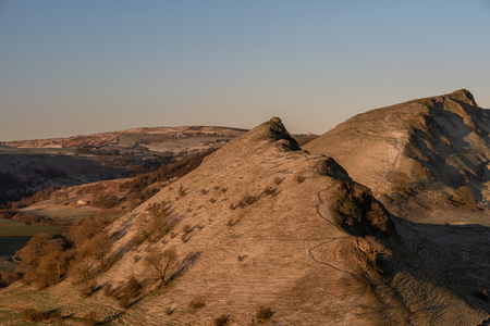Sunrise on Parkhouse Hill and Chrome Hill from Hitter Hill in the Peak District National Park.
