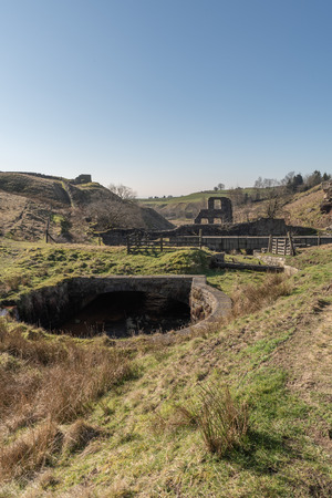 The ruins of Cheesden Lum Mill and waterfall near Haywood, Greater Manchester.