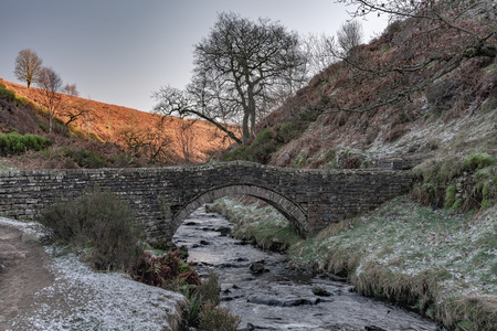 A packhorse bridge at Goyt valley within the Peak District National Park. Stock Photo