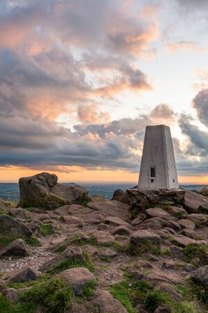 The trigonometry point on top of The Roaches at sunset in the Peak District National Park.