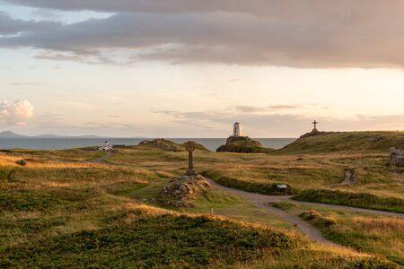 The Llanddwyn island lighthouse, Twr Mawr at Ynys Llanddwyn on Anglesey, North Wales at sunset. 스톡 콘텐츠 - 132786714