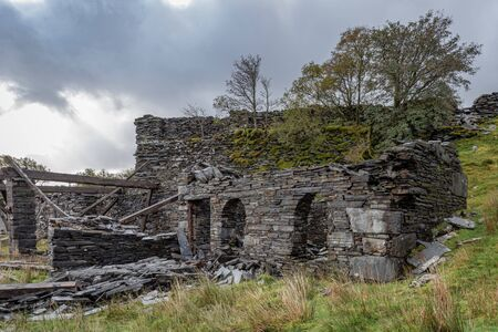 The abandoned Rhos Slate Quarry at Capel Curig, below Moel Siabod in the Snowdonia National Park, Wales Stock Photo