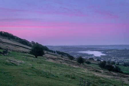 A panoramic view of Tittersworth reservoir shrouded in mist from The Roaches in the Peak District National Park, Staffordshire, UK 스톡 콘텐츠 - 132786736