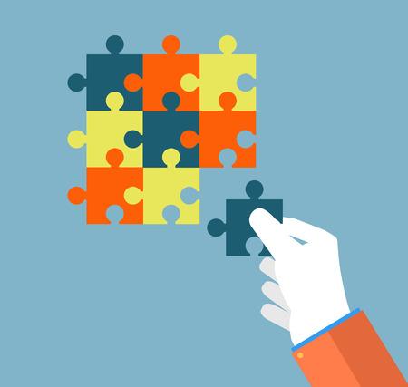 proper: Persona di fare un puzzle. Una mano mette una corretta puzzle. Uomo d'affari assemblaggio puzzle. Concetto di business