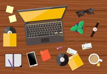 bovenaanzicht plant: Bovenaanzicht van hout werkplek met laptop, cd, smartphone, horloge en documenten met grafieken en grafieken op houten tafel
