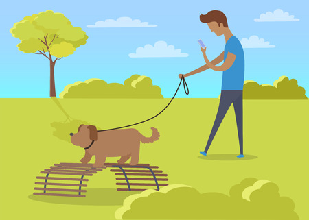 Young Boy Walking with Dog and Using Phone in Park