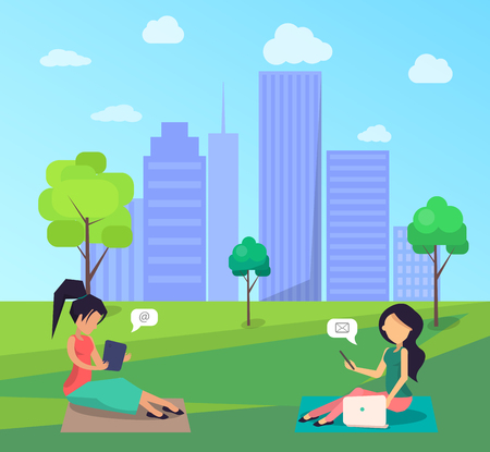 Two Women Sitting on Lawn in Central City Park
