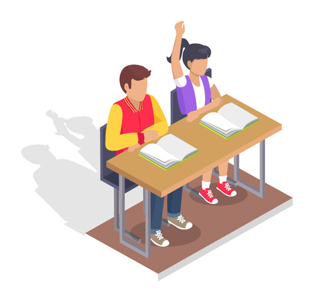 Two students boy and girl sitting at desk with open textbooks.