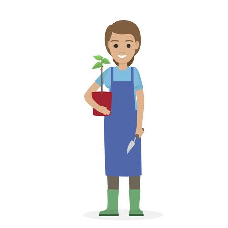 Glücklicher Gärtner mit Anlage im Topf und in der Gartenschaufel. Standard-Bild - 92183139