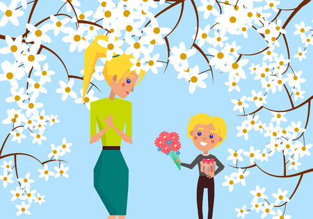 Little Boy Holds Gift and Flowers for Blonde Mom