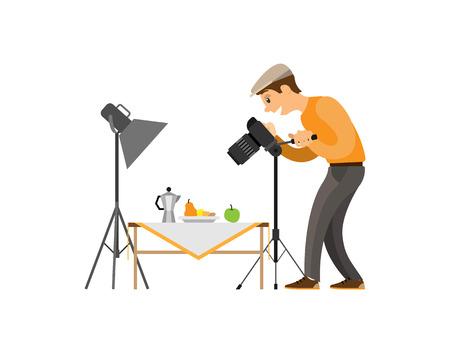 Photographer making shot of still life composition. Man with camera taking photo, teapot near fruits on table under spotlight vector illustration. Illustration