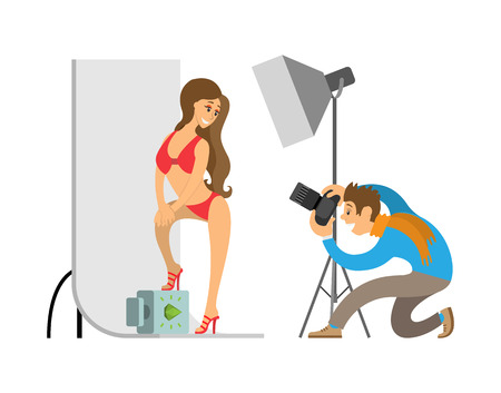 Photographer and Model in Swimsuit in Photo Studio 写真素材