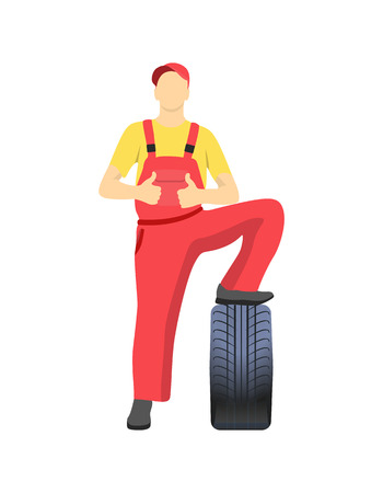 Mechanic Standing on Tire and Shows Approval Sign