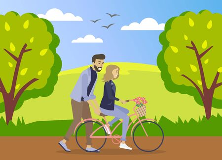 Happy young man is helping a smiling woman to ride a bicycle on the road at summer forest background. Girl is riding a pink bicycle with a bouquet of flowers in a basket. Romantic ride in the park Vettoriali