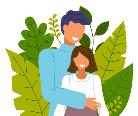 Happy couple smiling and laughing, embracing and touching tenderly on the background of greenery and big green leaves. Boyfriend and girlfriend hugging, spend time together. Health care concept