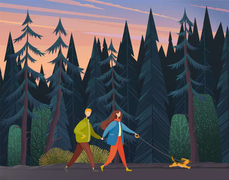 Young woman and man holding each others hand, walking together outdoor with small dog along the forest road in the evening. Romantic pastime concept, family weekend and walks with pet in autumn park Vetores
