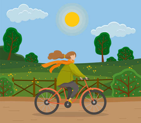 Girl on the bike. Woman going by bicycle on countryside, forest or city park wearing in warm clothes, active and healthy transport. Sport and outdoor activity, exercising and healthy lifestyle