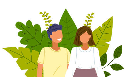 Healthy lifestyle and care for nature. Happy couple smiling and laughing, embracing and touching tenderly on the background of greenery and big green leaves. Nature conservation society concept