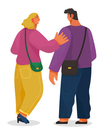 Man and woman talking to each other. Girl glad to meet a friend greets him friendly pat on the shoulder. Male and female characters back view full height. Communication of people. Staff conversation