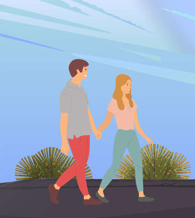 Young woman and man in love, holding each other s hand, walking together outdoor in the evening. Date of a loving happy couple. Romantic pastime concept. Relationships between male and female