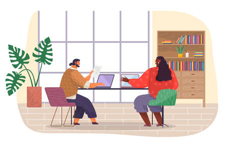 Office staff, wokrplace. Bearded man with fashionable haircut sits on chair at table, works at laptop, typing document. Dark-skinned girl in blouse shows on laptop. Wooden bookcase with books, folders