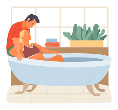 Pregnancy preparing, wife and husband joint birth. Pregnant woman giving natural birth in a bathtube full of water in bathroom interior. Active position use to reduce pain during childbirth