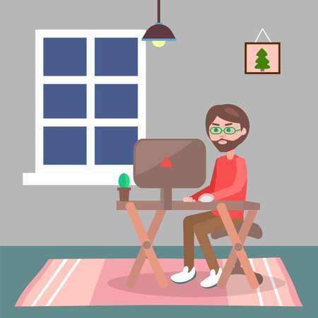 Man in casual clothes sitting at home on chair and browsing or working on computer in evening. Male bearded character works at home, freelancer at the desk. Remote worker or student in the room
