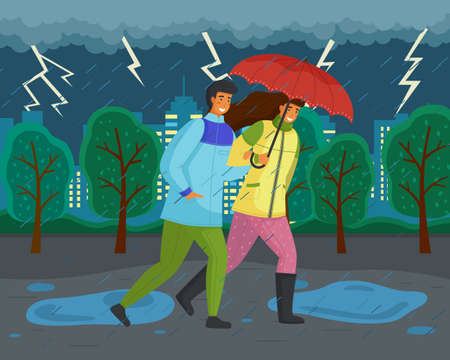Family walks in autumn park. Girl in yellow puffer jacket, guy wears blue windbreaker, carries red umbrella. Fall landscape, lightning, ominous atmosphere. Dark landscape. Terrible lousy weather
