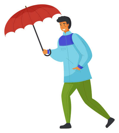 Young man in blue jacket or windbreaker, green pants, jeans walking with red umbrella in hands. Strong wind and rain. Dress warmly when bad weather. Autumn nasty weather. Man overcomes windy gusts