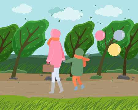 Windy autumn cold weather, mom wears pink jacket, child in green down jacket with colorful balls, back view, walk through autumn park. Wind tilts the trees. Fall weather, leaf fall. Clouds in the sky